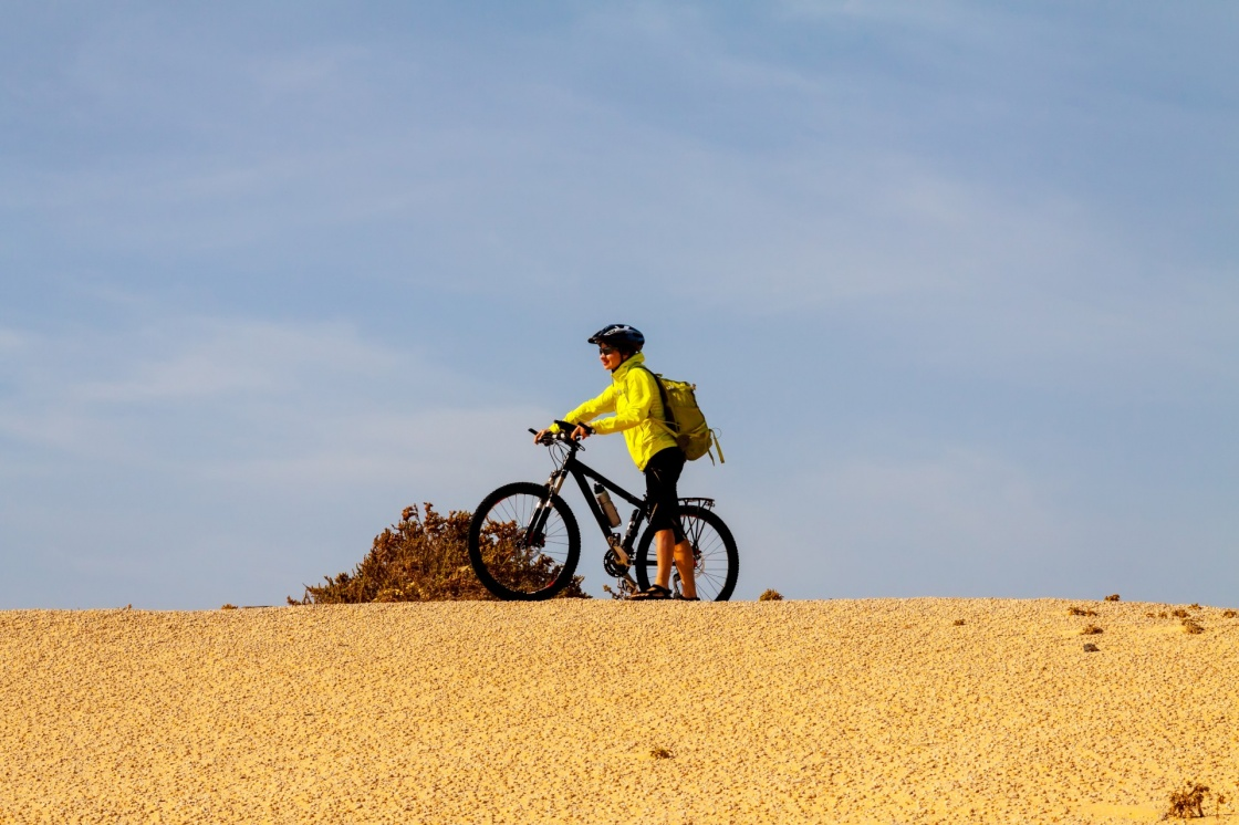woman in yellow riding bike on on Canary island